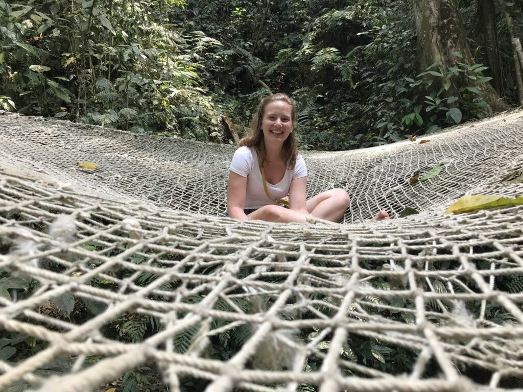 girls sitting in a net in the jungle
